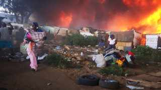 A fire broke out and destroyed shacks in Booysens Reserve near Selby Johannesburg. Picture: Simphiwe Mbokazi/African News Agency(ANA)
