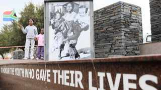 Kamogelo Matlala, 9, stands proudly with her sister Mahlatse, 4, at a June 16 Hector Pieterson Memorial Commemoration Day in Soweto. Picture: Antoine de Ras/ANA