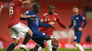 Chelsea's N'Golo Kante and Manchester United's Aaron Wan-Bissaka during the Premier League match at Old Trafford, Manchester.