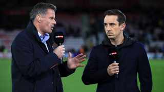 FILE - Former Liverpool defender and current Sky Sports pundit Jamie Carragher, left, believes Manchester United have what it takes to win the Premier League title. Photo: John Walton/PA Wire