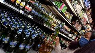 Online social media users have taken to community groups and notice boards on Facebook to find out how to get their hands on alcohol. Picture: African News Agency