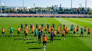 Valencia football club shows players and staff showing their support to Valencia's French defender Mouctar Diakhaby (C) as they protest against racism during a training session in Valencia. Photo: Lazaro Pena/AFP