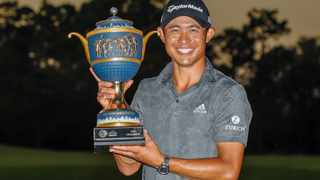 Collin Morikawa poses with the trophy after winning the World Golf Championships at The Concession Golf Club. Picture: Mike Watters/USA TODAY Sports via Reuters