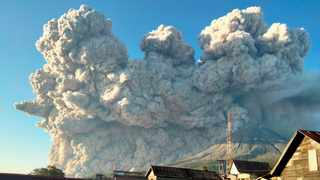 Mount Sinabung spews some 5,000-metre-high of hot ash into the sky seen from Karo, North Sumatra. Picture: Sastrawan Ginting / AFP
