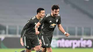 Manchester United's Bruno Fernandes celebrates scoring their second goal with Mason Greenwood. Photo: Massimo Pinca/Reuters