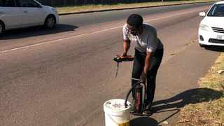 South Durban Community Environmental Alliance air quality and officer Bongani Mthembu takes an air samples using two of the instruments which are the Tiger and bucket. Picture supplied by SDCEA.