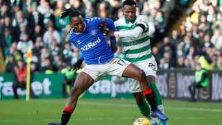 Rangers' Joe Aribo tries to hold off Celtic's Boli Bolingoli-Mbombo during a Scottish Premiership match. Picture: Russell Cheyne/Reuters