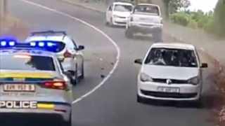 In video footage that went viral on social media, three police vehicles can be seen chasing a speeding bakkie allegedly hijacked in Grassy Park. Screengrab
