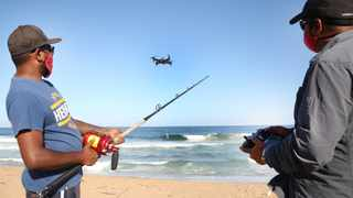 Tyron Ragunath from SwellPro and chairperson of the SA Drone Angling Association, Yugen Govender, are geared up and ready to fish at the La Mercy Beach, North of Durban. Picture: Zanele Zulu/ANA