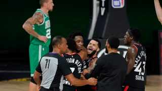 Teammates mob Toronto Raptors' OG Anunoby, second player from left, after his game-winning shot against the Boston Celtics. Picture: Mark J. Terrill/AP