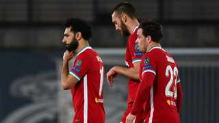 (L-R) Liverpool's Egyptian midfielder Mohamed Salah, defender Nathaniel Phillips and midfielder Xherdan Shaqiri react at the end of after their loss to Real Madrid in the first leg. Photo: Gabriel Bouys