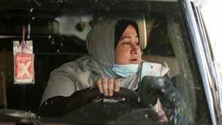 The first female Palestinian taxi driver in the Gaza Strip, Nayla Abu Jubbah, 39. Picture: Mahmud Hams/AFP