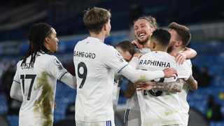 Leeds United's Stuart Dallas celebrates scoring their second goal with Luke Ayling and teammates. Photo: Gareth Copley/Reuters