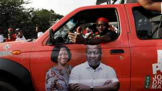 Supporter of the opposition National Democratic Congress drives a campaign vehicle ahead of the December 7th presidential and parliamentary elections in Accra, Ghana. Picture: Francis Kokoroko/Reuters