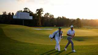 Dustin Johnson walks off the 18th green after completing his third round at the Masters. Picture: Brian Snyder/Reuters