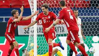 Bayern's Javi Martinez, second from left, celebrates after scoring the winner in the Uefa Super Cup final against Sevilla. Picture: Laszlo Balogh, AP