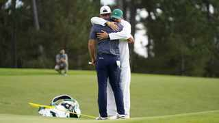 Dustin Johnson of the US embraces his caddie and brother Austin Johnson after sinking his putt to win on the eighteenth hole during the final round of the 2020 Masters. Photo: EPA/Tannen Maury