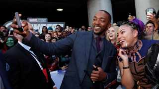 Cast member Anthony Mackie poses with fans on the red carpet at the world premiere of the film 'The Avengers: Endgame' in Los Angeles. Picture: AP
