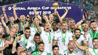 FILE - Algeria's Riyad Mahrez lifts the trophy after they beat Senegal in the final of the 2019 Africa Cup of Nations in Egypt. Photo: Suhaib Salem/Reuters