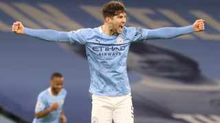 Manchester City's John Stones celebrates scoring their third goal in their Premier League game against Crystal Palace on Sunday. Photo: Clive Brunskill/Reuters
