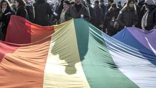 People hold a giant rainbow flag during a demonstration to support gay marriage and adoption. Nigerian lawmakers have approved a bill to outlaw gay marriage and crack down on gay rights.