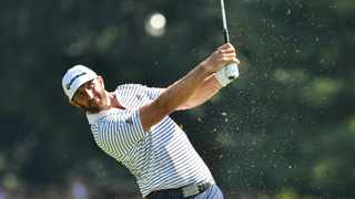 Dustin Johnson looked poised to make golf history after a blistering start at the Northern Trust on Friday but had to settle for a second-round 11-under 60 and a two-stroke lead over Scottie Scheffler. Photo: Mark Konezny/USA TODAY Sports