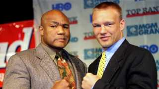 IBF heavyweight champion George Foreman and German heavyweight champion Axel Schulz pose at the Hollywood Theatre in Las Vegas, where 46-year-old Foreman won on a controversial split decision. Photo: Reuters