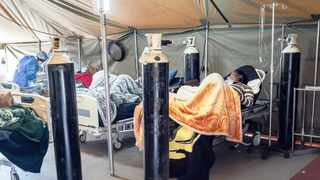 In this July 10, 2020, file photo, COVID-19 patients are treated with oxygen at the Tshwane District Hospital in Pretoria.
