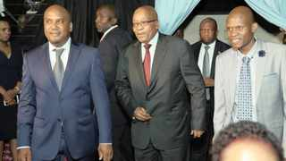 Former president Jacob Zuma arrives at the gala dinner for the National Funeral Practitioners Association of South Africa with the association's Muzi Hlengwa, right, and Nkosentsha Shezi, left, at the Olive Convention Centre in Durban. Picture: The Mercury