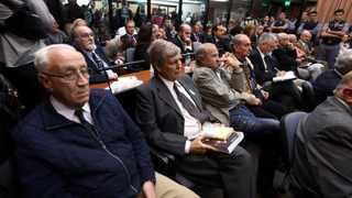 Former Argentine navy officers Jorge Acosta (L) and Alfredo Astiz (2nd R) and other members of Argentina's Naval Mechanics School, known as the ESMA, attend the sentence hearing of the five-year trial for their role during the 1976-1983 dictatorship in Buenos Aires. File picture: Marcos Brindicci/Reuters