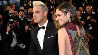 British singer Robbie Williams and his wife Ayda Field. Picture: AFP