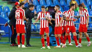 Two members of Atletico Madrid's group set to travel to Portugal for the Champions League quarter-finals have tested positive for Covid-19. Photo: Juan Medina/Reuters