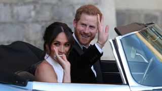 File photo: The newly married Duke and Duchess of Sussex, Meghan Markle and Prince Harry, leave Windsor Castle in a convertible car after their wedding in Windsor. Picture: AP