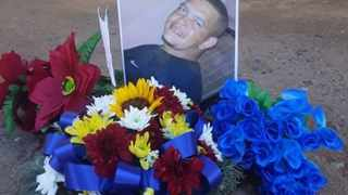Residents laid flowers where Riaan Syster's body was found. Picture supplied