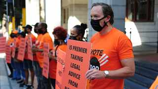 Good party secretary general Brett Herron and party members picket outside the Provincial Legislature in Wale Street. Picture: Henk Kruger/African News Agency (ANA)
