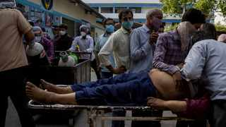 Family members mourn after Shayam Narayan is declared dead outside the coronavirus disease casualty ward, at Guru Teg Bahadur hospital, amidst the spread of the disease in New Delhi. Picture: Danish Siddiqui/Reuters