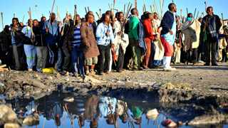 14.05.2014 Hundreds of striking miners chanting pro-AMCU songs as they match in Marikana, thousands of mine workers were supposed to go back to work today. Picture: Itumeleng English