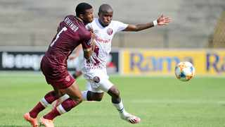 Thabo Matlaba of Swallows FC is challenged by Sibusiso Mthethwa of Stellenbosch FC during their DStv Premiership game at Danie Craven Stadium in Stellenbosch on Sunday. Photo: Ryan Wilkisky/BackpagePix