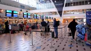 Passengers queue at the Cape Town International Airport. Picture: Ayanda Ndamane/African News Agency(ANA)