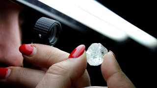 FOCUSING ON SKILLS: A 30-carat rough diamond is viewed at the offices of a polishing factory in Antwerp. De Beers wants to increase cutting and polishing skills in South Africa. Picture: Reuters