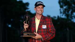 Webb Simpson holds the championship trophy after winning the RBC Heritage. Picture: Gerry Broome/AP