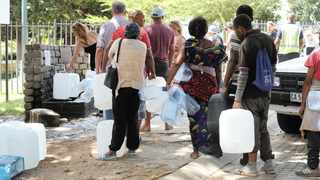 The Newlands Spring has seen an increase of people arriving with plastic containers to collect natural spring water. Long queues of people wait their turn to fill up their containers with spring water. Pictures: Henk Kruger/African News Agency (ANA)
