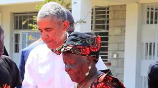 Former US president Barack Obama assists his grandmother Sarah Obama at the Sauti Kuu resource centre near his ancestral home in Nyangoma Kogelo village in Siaya county, western Kenya. File picture: Thomas Mukoya/Reuters