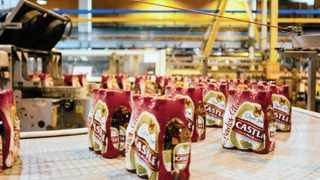 Packaged six packs of Castle beer move along a conveyor belt at the end of the production line at SABMiller Plc's Newlands brewery. File picture: Waldo Swiegers/Bloomberg