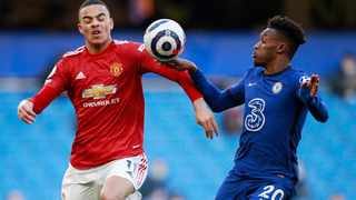Chelsea's Callum Hudson-Odoi appears to handle the ball while in action with Manchester United's Mason Greenwood during their Premier League meeting at Stamford Bridge in London on Sunday. Photo: Ian Walton/Reuters