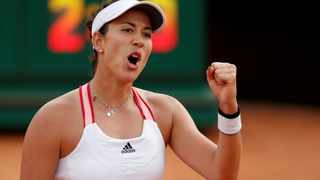 Spain's Garbine Muguruza celebrates after winning her Italian Open quarter-final against Belarus' Victoria Azarenka. Photo: Clive Brunskill/Reuters