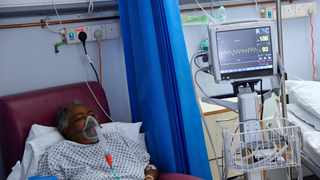 Covid-19 patient Myrtle Grossett takes oxygen in the HDU (High Dependency Unit) at Milton Keynes University Hospital, amid the spread of the coronavirus disease (Covid-19) pandemic. Picture: Toby Melville/Reuters