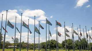 South African national flags fly at halfmast next to the N4 freeway. Picture: Jacques Naude/African News Agency (ANA)