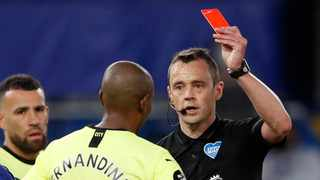 Premier League referee Stuart Attwell will be able to send off a player who deliberately coughs in the direction of an opponent or a referee. Picture: Adrian Dennis/Reuters