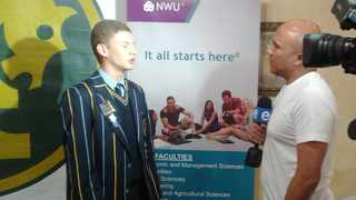 Theunis van der Merwe being interviewed after having been presented his bursary by NWU officials. Picture: Supplied